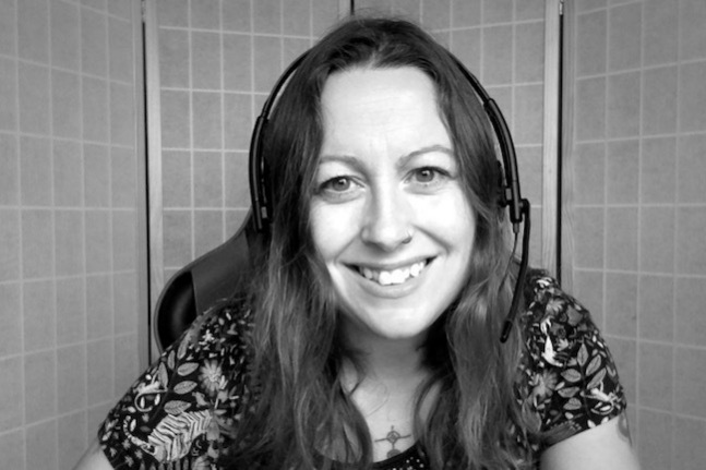 Photograph of me, the counsellor, wearing a headset with a plain screen behind me